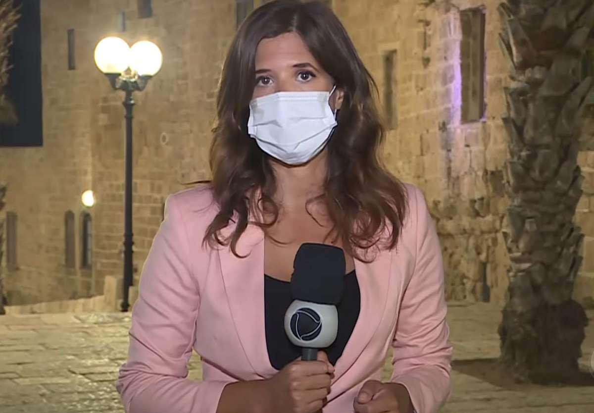 Bianca Zanini em sua primeira reportagem para o Jornal da Record